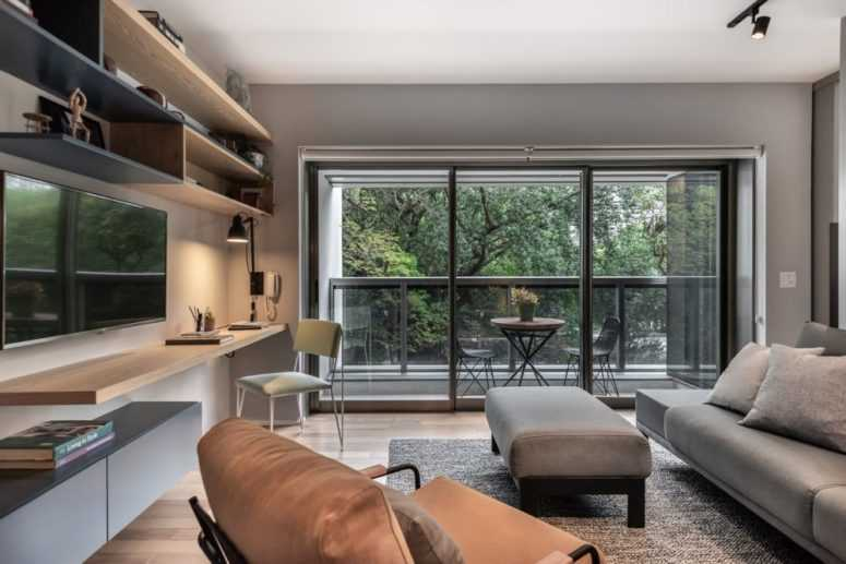 This contemporary apartment is only 50 square meters, and the designers used many cool features and clever furniture to make it work