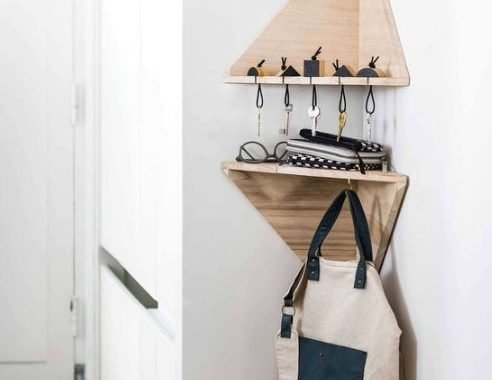 Tiny Geometric Corner Shelves With A Key Holder And Some Hooks Are A Great Idea For A Tiny Entryway