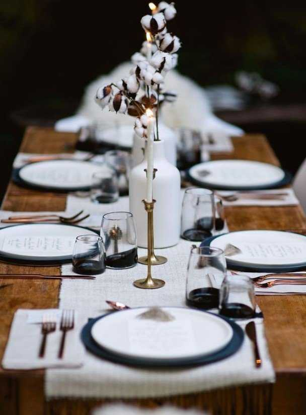 A Monochromatic Winter Tablescape With A White Runner And Placemats,
