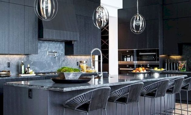 A Black Kitchen With Textural Cabinets A Kitchen Island With A Stone Countertop And Woven Stools Plus Pendant Lamps