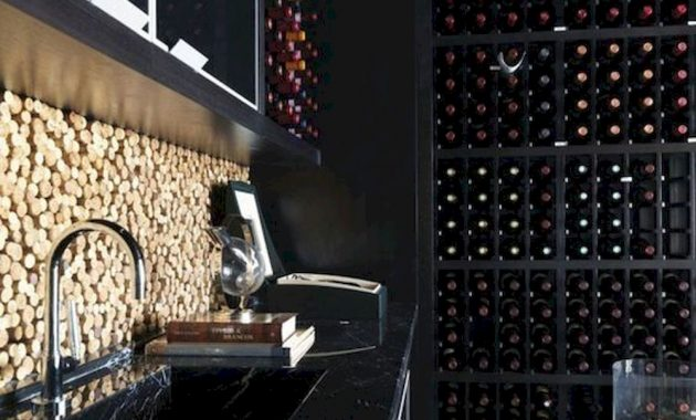 A Black Marble Kitchen With A Cork Backsplash A Large Wine Cellar For A Stylish Moody Masculine Kitchen