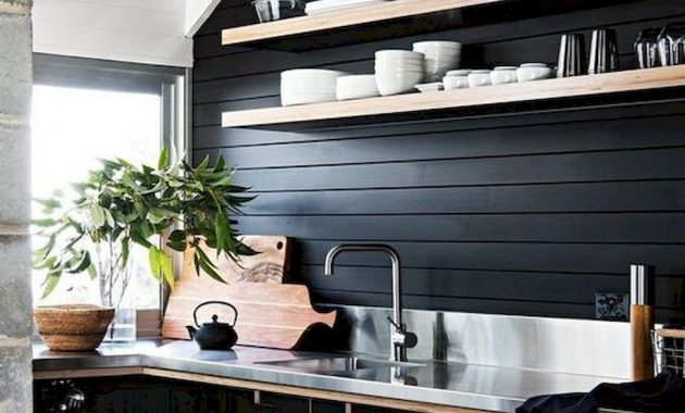 A Black Masculine Kitchen With Contrasting Light Colored Shelves Handles And Countertops Plus A Burlap Pendant Lamp