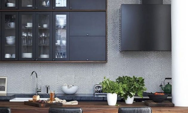A Masculine Kitchen With Graphite Grey Cabinets A Wooden Kitchen Island Black Leather Stools And A Black Hood