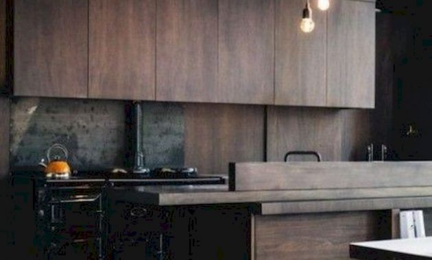 A Moody Wooden Kitchen With Pendant Lamps A Metal Backsplash And A Hearth For More Coziness