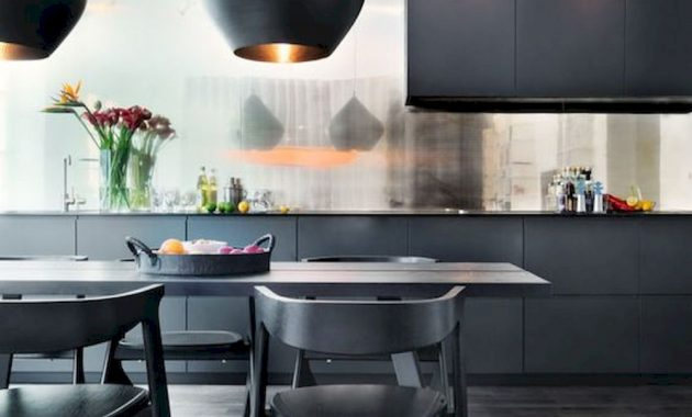 A Refined And Elegant Black Kitchen With A Shiny Backsplash Sleek Cabinets A Dining Set In Black And Catchy Pendant Lamps
