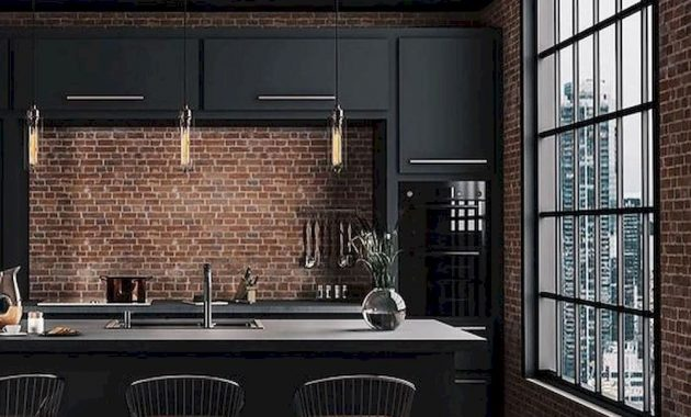 A Stylish Moody Kitchen With Black Cabinets Gold Touches A Large Kitchen Island And Red Brick Walls