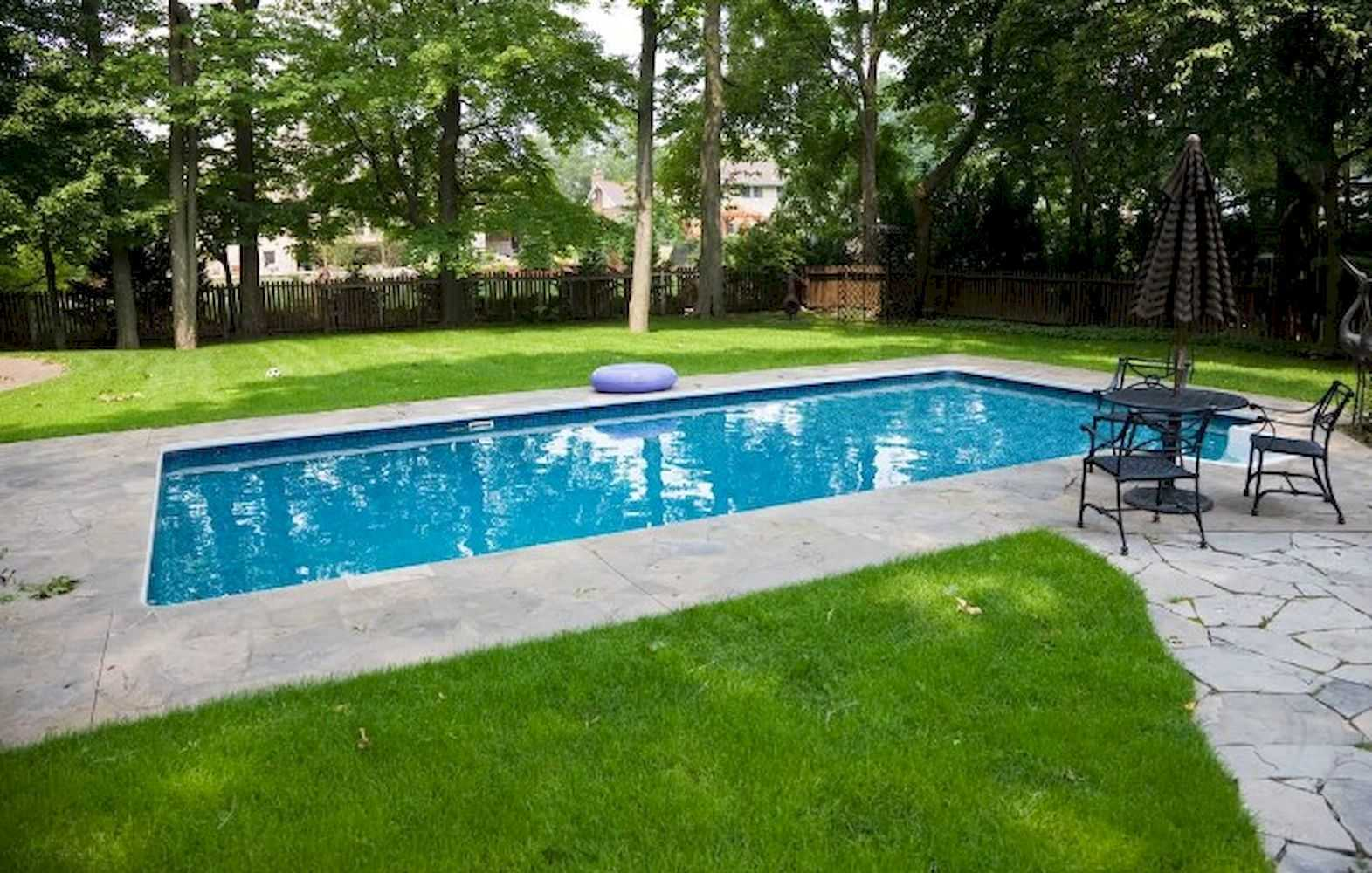 A Rectangle Outdoor Pool Surrounded By Gardens