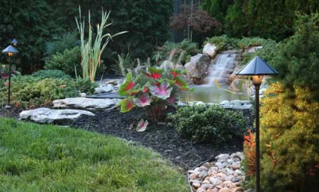 Pond With A Stone Waterfall Is Slightly Off The Beaten Path Of The Yard