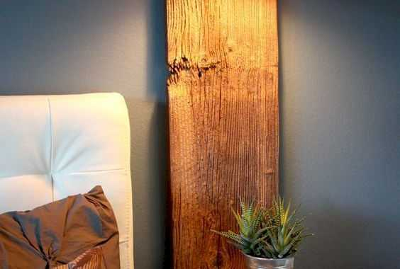 A Rustic Floating Nightstand With A Wooden Plank Attached To The Wall And A Horizontal Part