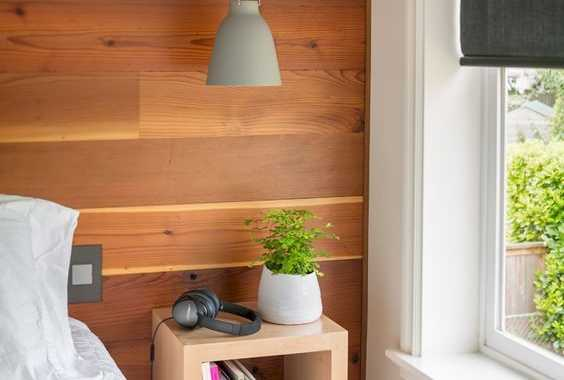 An Open Wooden Box Storage Shelf For Bedside Storage