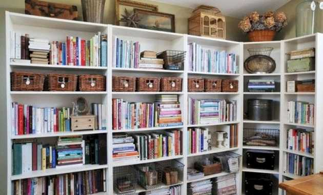 Several Bookcases Connected Together Provide A Lot Of Storage Space For Books Magazines Boxes And Other Stuff.