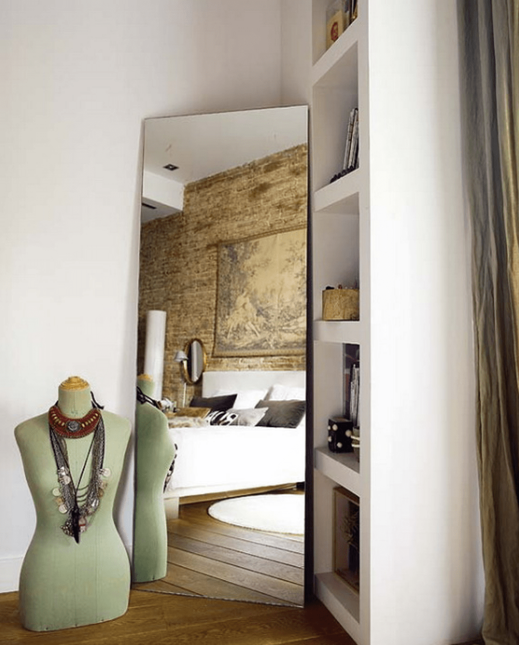 A Mirror In The Corner Gives Some Volume To The Bedroom