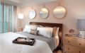 Identical Round Mirrors Above The Bed
