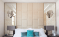 Symmetrical Mirrors With A Leather Headboard