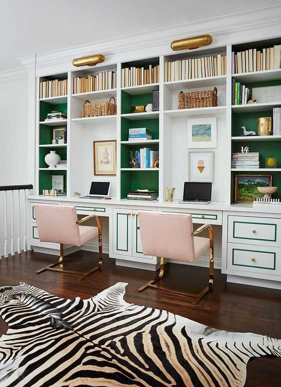 Small Desk Stuck Between Two Bookcases With Drawers