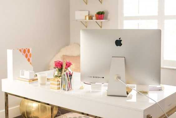 White Desk With Gold Framing For A Glam Office