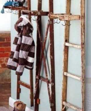 Old wooden ladders makes it way into your living space with a little modification. It can handle your coats for you!
