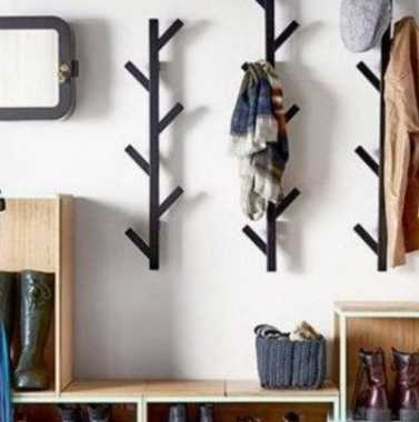 These coat racks form the appearance of little trees without leaves. They're cute and can be easily constructed using reclaimed wood of old furniture.