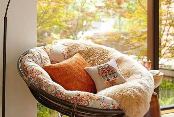 A Cool Papasan Chair Of Dark Sturdy Wood With A Colorful Futon And Pillows To Form A Cozy Reading Nook By The Window