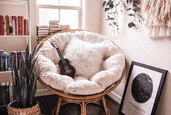 A Cool Music Playing Nook With A Papasan Chair Of Rattan With A White Futon And A Faux Fur Pillow Is Amazing