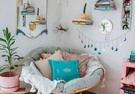 A Colorful Boho Nook With A Papasan Chair With Pastel Pillows A Macrame Chandelier And Potted Greenery And Bright Touches