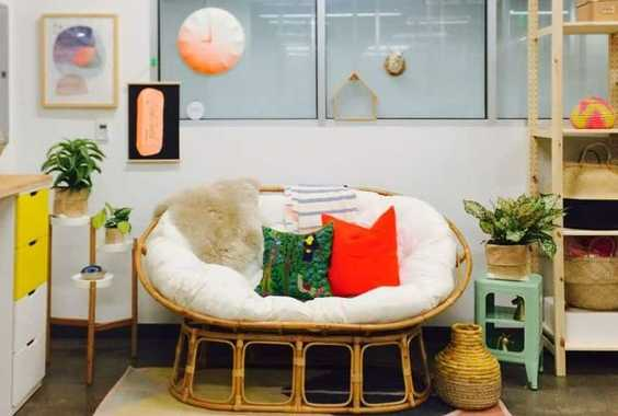 A Rattan Mamasan Chair With Colorful Pillows Is A Great Nook To Spend Time Together