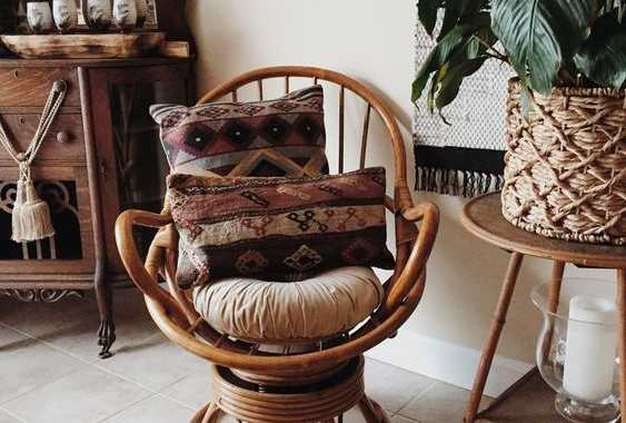 A Rattan Swivel Rocker Chair With Boho Pillows And Rugs Is A Cool Idea To Finish Off A Boho Space