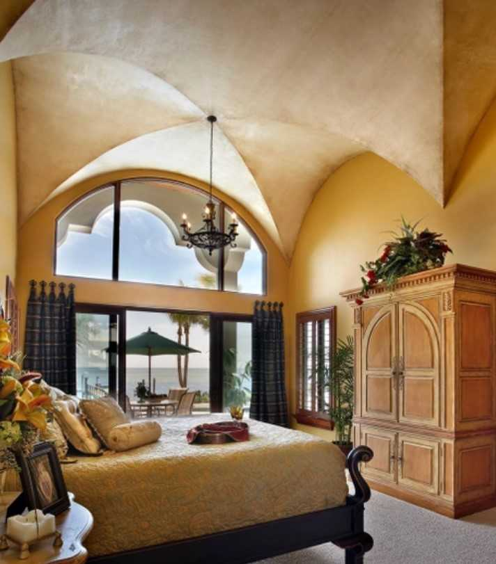 Mediterranean Styled Bedrooms Are Accented With Vintage Furniture
