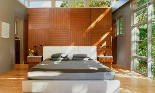 Wooden Treatment Behind Headboard Adds To The Look Of The Asian Modern Bedroom