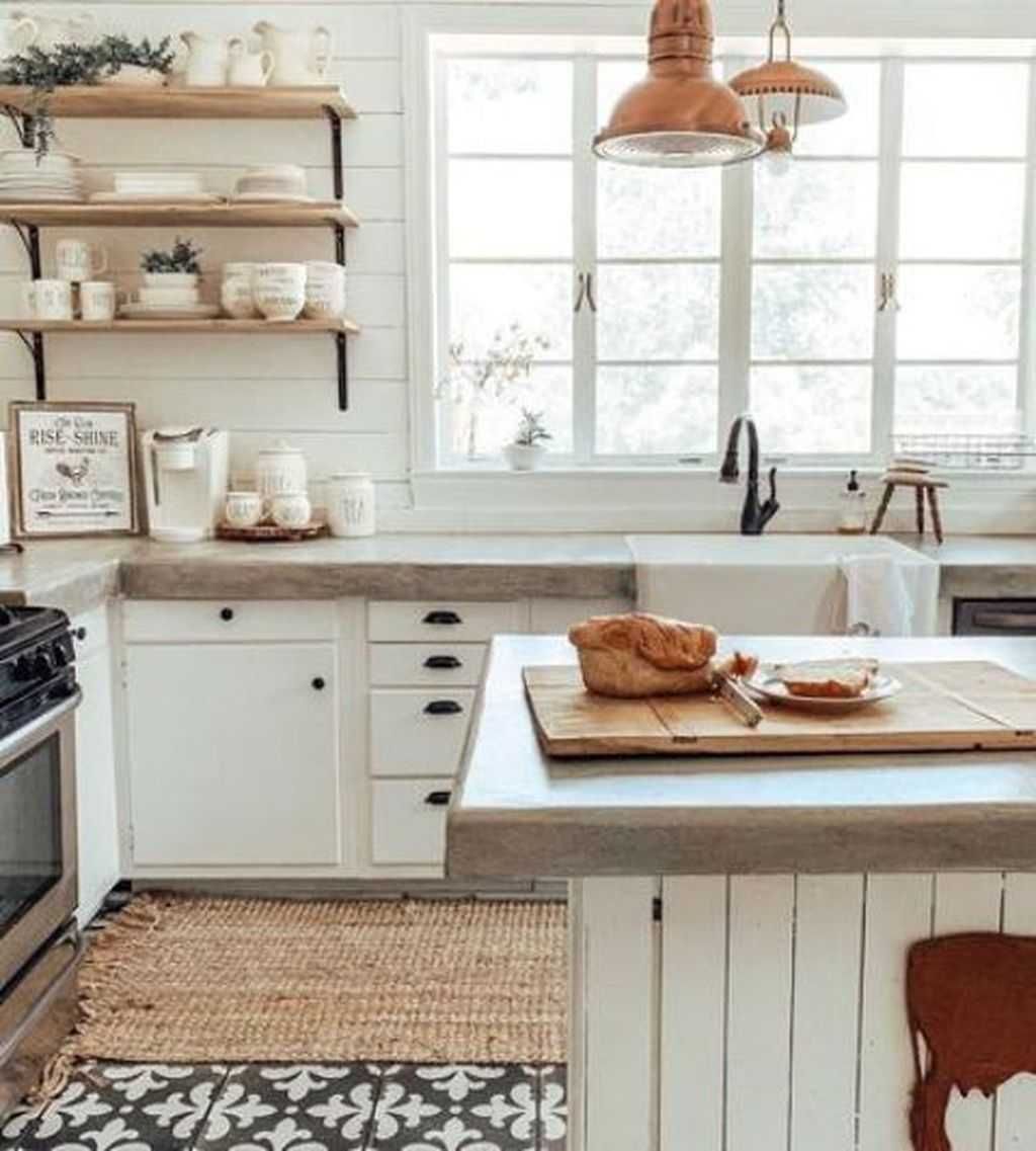 A White Farmhouse Kitchen With Simple Cabinets