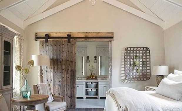 French Country Bedroom With A Beautiful Antique Door Or A Pair Of Sliding Barn Doors