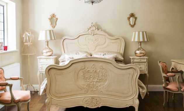 French Country Bedroom With Elegant Louis Xv Chairs In Soft Pink And An Elaborately Carved Bed