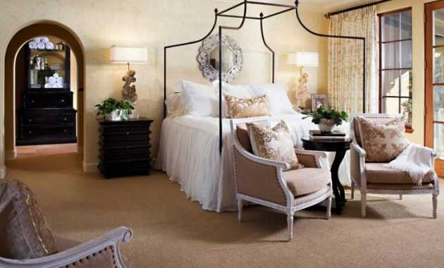 French Country Bedroom With A Wonderfully Ornate Mirror And Some Beautiful Accent Chairs