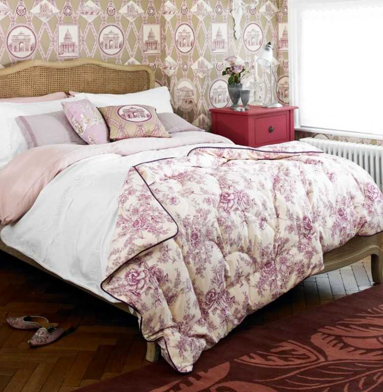 French Country Bedroom Features A Stunning Canopy Bed And Bold Wallpaper.