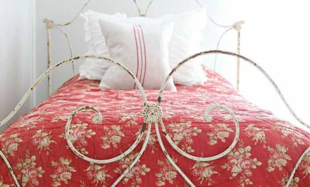French Country With Antique Iron Bed And Red Floral Bedspread