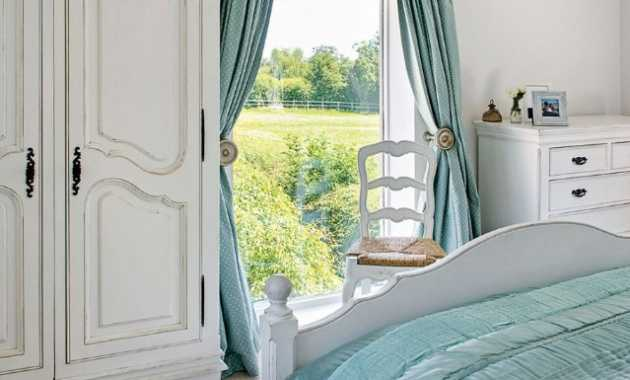 Lucky Enough To Have A Large Window With A View Of The Countryside Cottage Bedroom