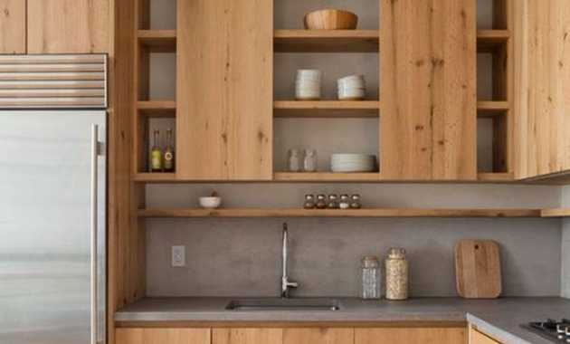 Minimalist Kitchen With Sleek Wooden Cabinets And A Concrete Countertop And Backsplash Is Super Stylish