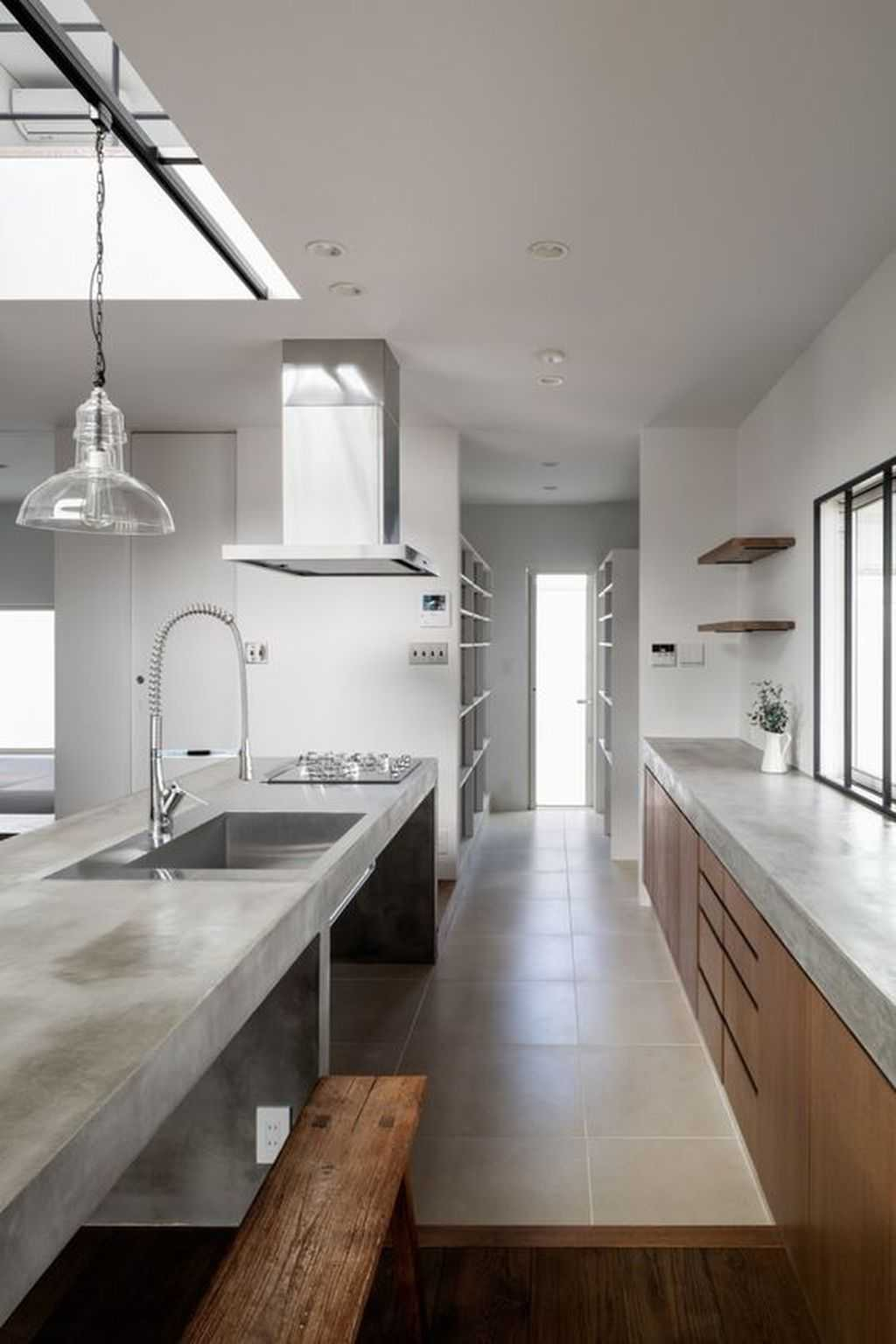 Minimalist Kitchen With Sleek Wooden Cabinets And A Concrete Countertop Plus A Concrete Kitchen Island