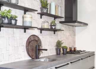 Modern Kitchen With Grey Cabinets Concrete Countertops And A Catchy Backsplash