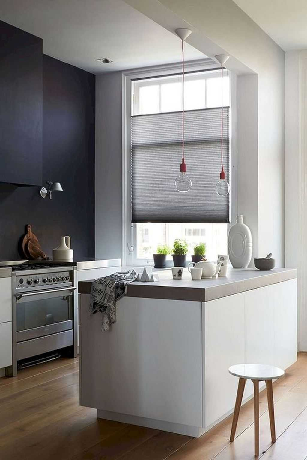 Monochromatic Minimalist Kitchen With Concrete Countertops And Bulbs On Red Cords