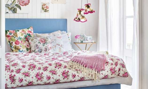 Pink Green And Blue Are Repeated Over And Over In The Bedding And On The Wall Art In Cottage