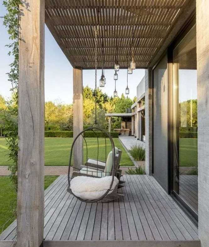 Porch With Rocking Chairs And Swing Chair.