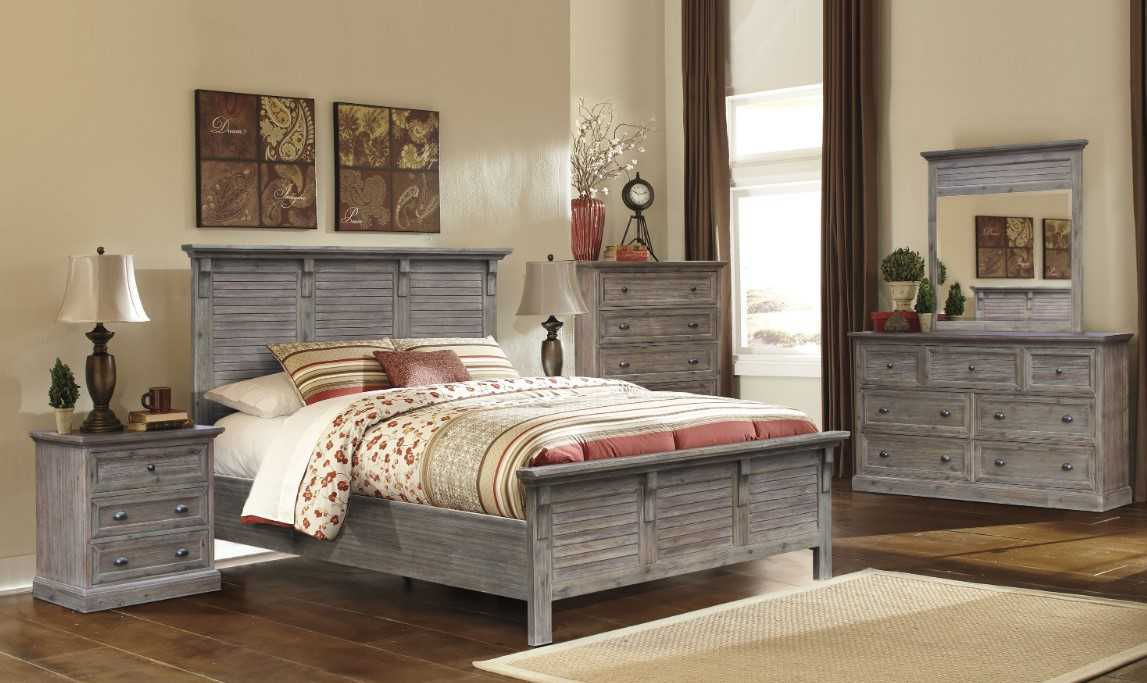 Cottage Bedroom With Gray Headboard Of The Bed That Has A Colorful Artistic Area Rug Underneath.