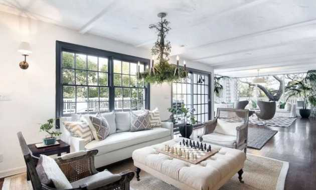 Traditional Living Room With Wood Flooring And Custom Chandelier With Branches And Leave