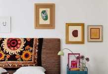 Bright Eclectic Bedroom With A Bight Vintage Nightstand Abstract Art A Wooden Chest And An Upholstered Bed
